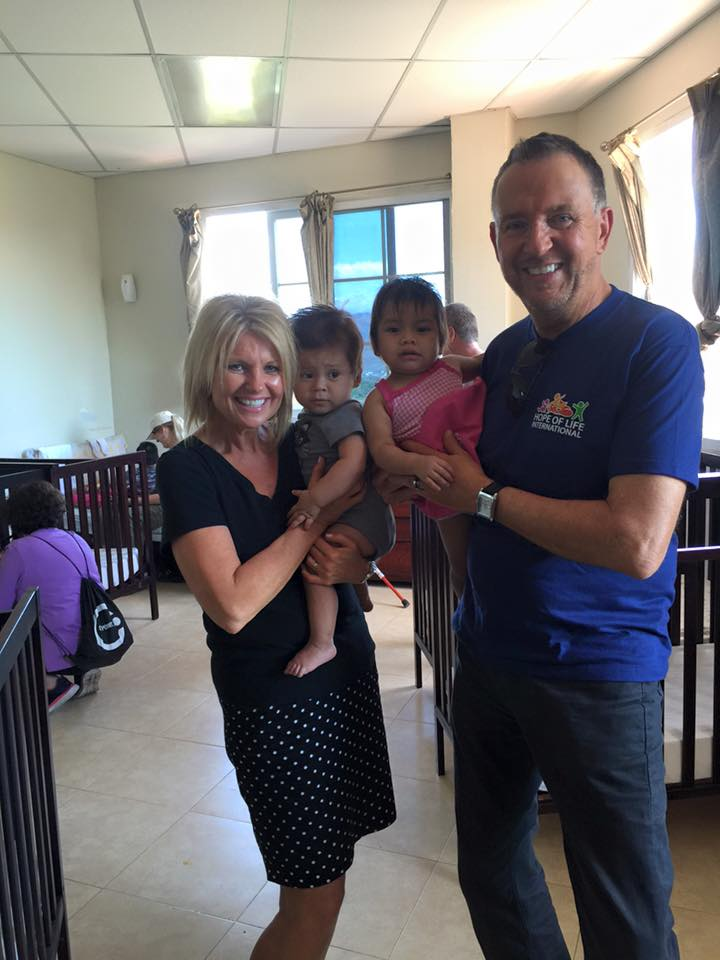 Pastor Steve and Holly holding babies