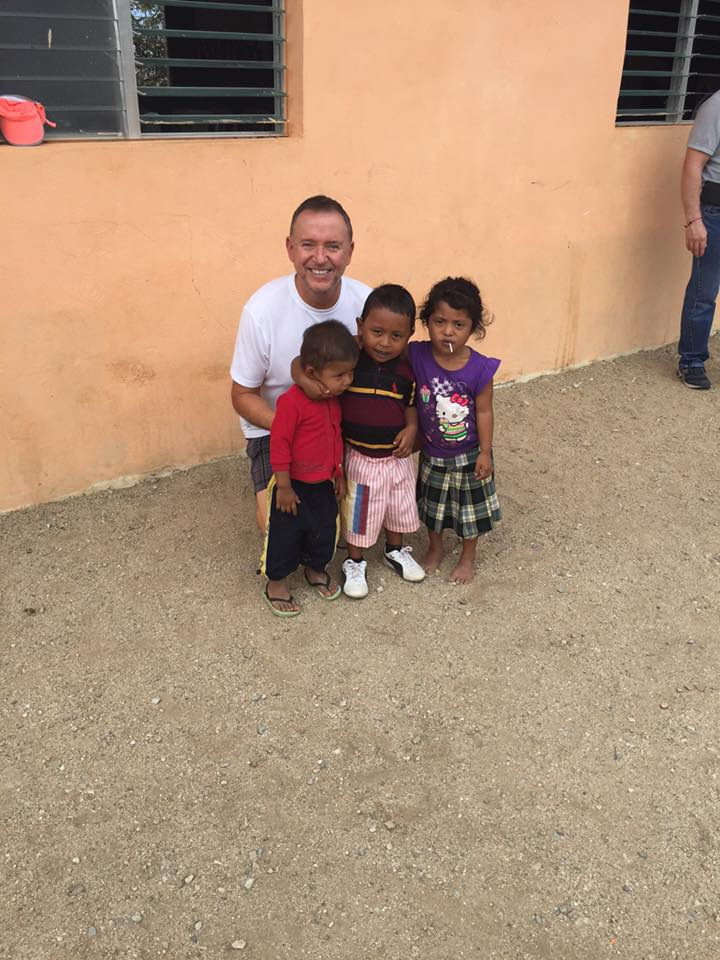 Pastor Steve with 3 young boys.