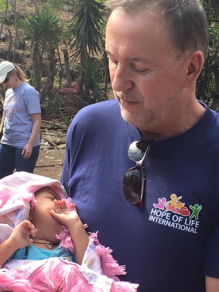 Pastor Steve holding infant boy