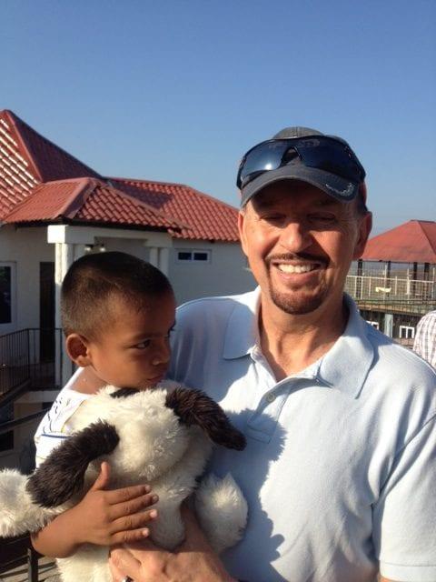 Pastor Steve holding young boy
