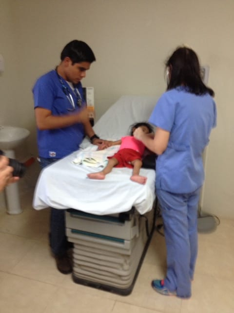 Doctors working to save malnourished child